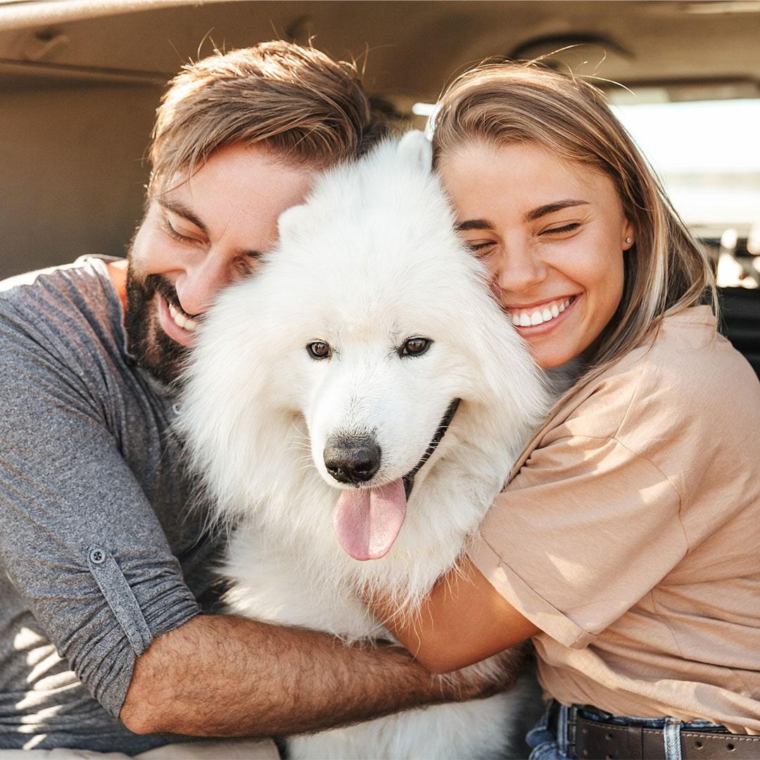 couple hug dog